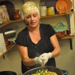 La Diva Cucina sautéing gnocchi and vegetables at a demonstration
