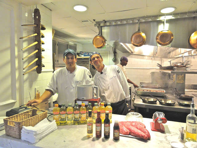 Casa Tua chefs directly from Italy, both lovely and talented, in front of the Bertolli oil and vinegar display.  And how about that big hunk of beef filet?  La Diva was drooling!